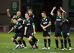 Hibs celebrate victory in the penalty shoot out as Nicky Law's shot is saved by Mark Brown