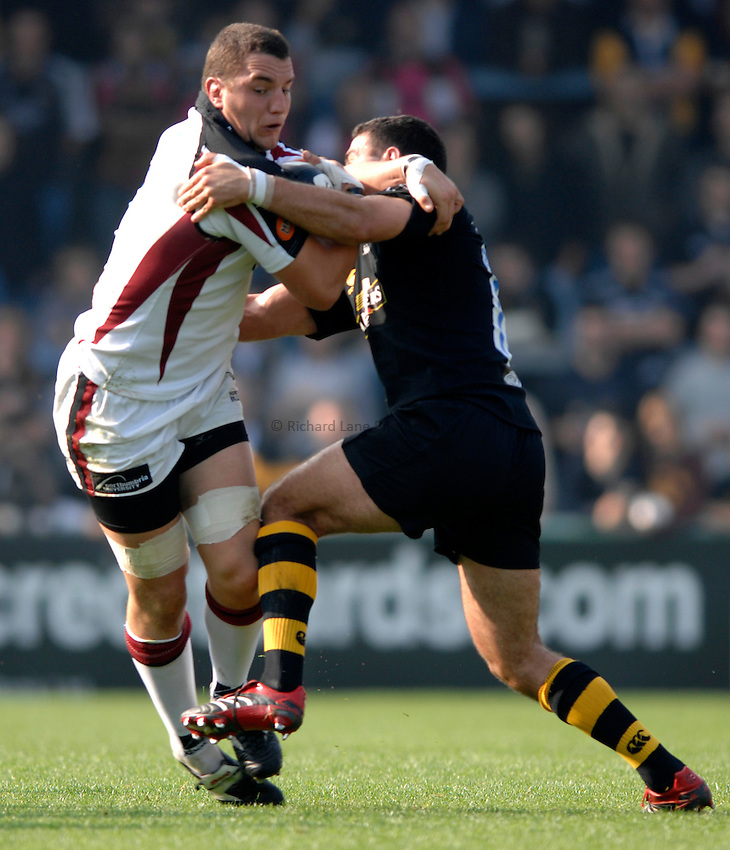 Photo: Richard Lane..London Wasps v Newcastle Falcons. Guinness Premiership. 15/10/2006. .Falcons' Phil Dowson is tackled by Jermey Staunton.