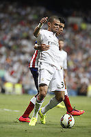 Pepe of Real Madrid and Raul Jimenez of Atletico de Madrid during La Liga match between Real Madrid and Atletico de Madrid at Santiago Bernabeu stadium in Madrid, Spain. September 13, 2014. (ALTERPHOTOS/Caro Marin)