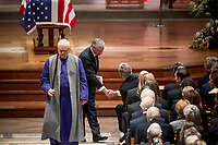 Presidential biographer Jon Meacham, second from left, shakes hands with former President George Bush after speaking during the State Funeral for former President George H.W. Bush at the National Cathedral, Wednesday, Dec. 5, 2018, in Washington.<br /> CAP/MPI/RS<br /> &copy;RS/MPI/Capital Pictures