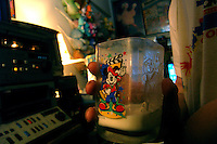 "Richard J. Concepcion, a.k.a. Rapid T. Rabbit, drinks milk in a Mickey Mouse glass at his apartment in Queens, New York, as he edits video for his cable access television show ""Rapid T. Rabbit and Friends.""   Furries are a group of people who identify themselves not as being human but as a walking, talking animal.  For some the lifestyle is complete, animal traits reach into every aspect of life from mundane trips to a grocery store to sexual fantasies.  For others, involvement in the furry fandom is limited to public performances and meet-and-greets."