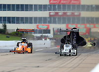 May 20, 2017; Topeka, KS, USA; NHRA top fuel driver Mike Salinas (left) alongside Shawn Langdon during qualifying for the Heartland Nationals at Heartland Park Topeka. Mandatory Credit: Mark J. Rebilas-USA TODAY Sports