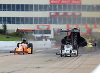 May 20, 2017; Topeka, KS, USA; NHRA top fuel driver Mike Salinas (left) alongside Shawn Langdon during qualifying for the Heartland Nationals at Heartland Park Topeka. Mandatory Credit: Mark J. Rebilas-USA TODAY Sports