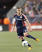 New England Revolution defender Chris Tierney (8) controls the ball.In a Major League Soccer (MLS) match, the New England Revolution (blue/red) defeated Philadelphia Union (blue/white), 2-0, at Gillette Stadium on April 27, 2013.