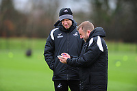 (L-R) Graham Potter Manager of Swansea City speaks with Billy Reid, assistant manager for Swansea during the Swansea City Training at The Fairwood Training Ground, Swansea, Wales, UK. Tuesday 22 January 2019