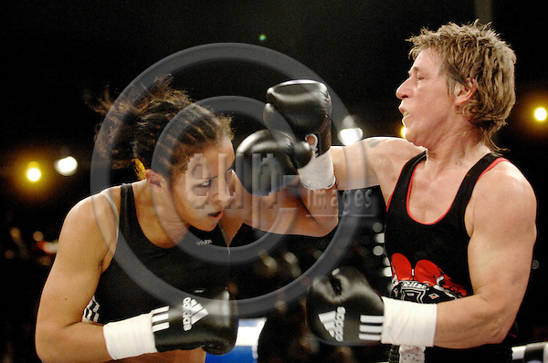 KIEL - GERMANY 28 FEB 2008 -- Norwegian proffessional boxer at the German team Sauerland, Cecilia BRAEKHUS (L) (BRÆKHUS) in Kiel in a fight with German Tatjana DIECKMANN. BRAEKHUS wins the match. -- PHOTO: © GORM K. GAARE/ EUP-BERLIN..