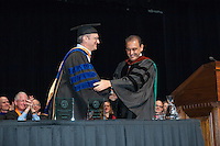 Daniel Snowden-Ifft, Professor, Physics receives The Graham L. Sterling Memorial Award from Jorge Gonzalez. Incoming first-years start the year at Occidental College's 127th annual Convocation ceremony on Aug. 28, 2013 in Thorne Hall.<br /> (Photo by Marc Campos, Occidental College Photographer)