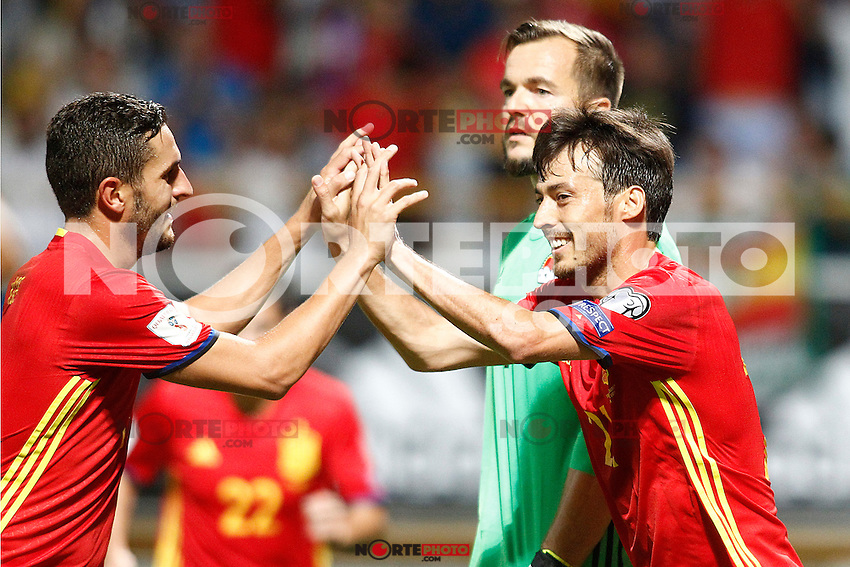 Spain's Koke Resurreccion (l) and David Silva celebrate goal in presence of Liechtenstein's Peter Jehle dejected during FIFA World Cup 2018 Qualifying Round match. September 5,2016.(ALTERPHOTOS/Acero) /NORTEPHOTO