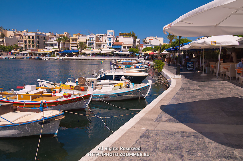 Boats and restaurants on lake Voulismeni in Agios Nikolaos, Crete