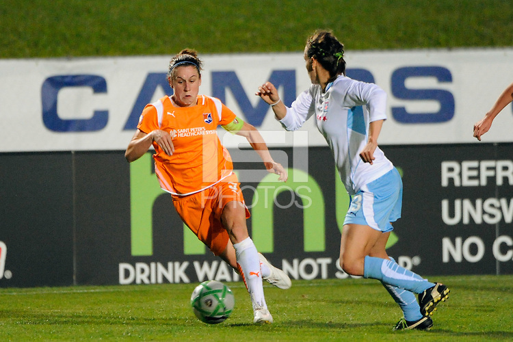 Heather O'Reilly (9) of Sky Blue FC is defended by Natalie Spilger (13) of the Chicago Red Stars. Sky Blue FC defeated the Chicago Red Stars 1-0 during a Women's Professional Soccer match at Yurcak Field in Piscataway, NJ, on June 17, 2009.