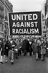 Racism 1970s London UK. United Against Racialism Labour Party and TUC rally and march Trafalgar Square 1976 England. Tom Jackson, General Secretary of the Union of Post Office Workers, (centre under 'A' ) and Barbara Castle Labour MP to his left.
