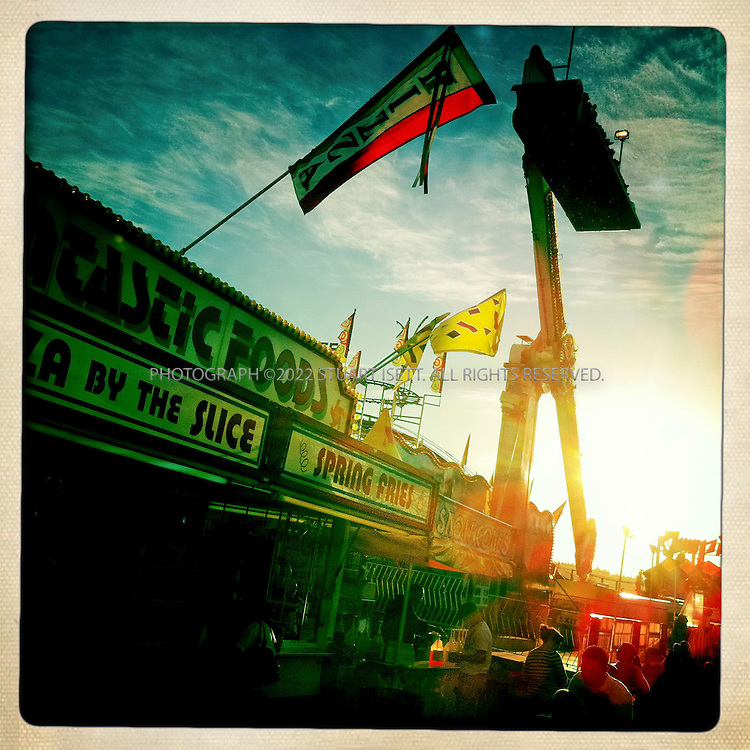 9/259/2010--Puyallup, WA, USA..The Puyallup Fair is the largest single attraction held annually in the state of Washington. The fair continually ranks in the top ten largest fairs in the United States. The Western Washington Fair Association hosts two annual events: the 17-day Puyallup Fair every September, and the four-day Puyallup Spring Fair every April...Situated in Puyallup, 35 miles (56 km) south of Seattle and 10 miles (16 km) east of Tacoma in the shadow of Mount Rainier, the fairgrounds comprise 160 acres (0.65 km2), with buildings and land valued at more than $54 million. The facilities are available for rent during the year, making the grounds a valuable community resource. A staff of 55 works year-round. Over 7,500 employees are hired each September during the Fair...©2010 Stuart Isett. All rights reserved.