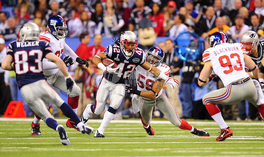 Feb 5, 2012; Indianapolis, IN, USA; New England Patriots running back BenJarvus Green-Ellis (42) runs past New York Giants outside linebacker Michael Boley (59) during the first half of Super Bowl XLVI at Lucas Oil Stadium.  Mandatory Credit: Mark J. Rebilas-
