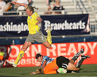 Beverly Goebel #6 of the Washington Freedom, playing in a special camouflage uniform has her shot saved by Val Henderson #1 of the Philadelphia Independence as Sara Larrson #7 leaps over both of them during a WPS match on military appreciation night at the Maryland Soccerplex in Boyds, Maryland on May 30 2010. Freedom won 2-1.