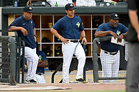 Coaches with the Columbia Fireflies in a game against the Charleston RiverDogs on Monday, August 7, 2017, at Spirit Communications Park in Columbia, South Carolina. From left, Joel Fuentes, Jose Leger and Jonathan Hurst. Columbia won, 6-4. (Tom Priddy/Four Seam Images)