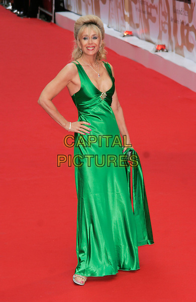SALLY FARMILOE.Red Carpet Arrivals for the British Academy Television Awards 2008, held at the London Palladium, London, England, .April 20th 2008. .BAFTA BAFTA's full length green dress Farmilow cleavage silver clutch bag purse hand on hip .CAP/AH.©Adam Houghton/Capital Pictures.