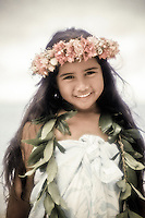 Little girl with leis on at the beach