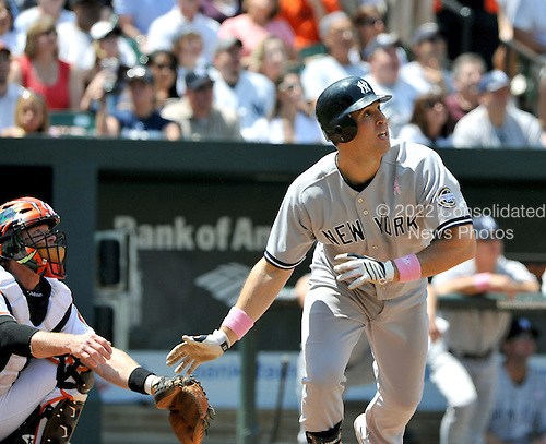 Baltimore, MD - May 10, 2009 -- New York Yankees first basemen Mark Teixeira (25) watches the flight of his first inning home run against the Baltimore Orioles at Oriole Park at Camden Yards in Baltimore, MD on Sunday, May 10, 2009..Credit: Ron Sachs / CNP.(RESTRICTION: NO New York or New Jersey Newspapers or newspapers within a 75 mile radius of New York City)