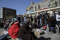 Pictured: Migrants outside the passenger terminal Thursday 03 March 2016<br /> Re: Migrants have been gathering at the port of Piraeus, near Athens, Greece
