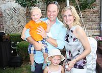 NWA Democrat-Gazette/CARIN SCHOPPMEYER Russ and Karisa Sprague, with their children Porter (left) and Delaney enjoy An Evening with Stacy Lewis.