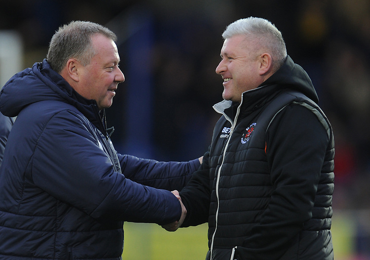 Blackpool's Manager Terry McPhillips (right) shakes hands with AFC Wimbledon manager Wally Downes<br /> <br /> Photographer Kevin Barnes/CameraSport<br /> <br /> The EFL Sky Bet League One - AFC Wimbledon v Blackpool - Saturday 29th December 2018 - Kingsmeadow Stadium - London<br /> <br /> World Copyright © 2018 CameraSport. All rights reserved. 43 Linden Ave. Countesthorpe. Leicester. England. LE8 5PG - Tel: +44 (0) 116 277 4147 - admin@camerasport.com - www.camerasport.com