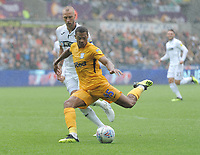 Preston North End's Lukas Nmecha shoots despite the attentions of Swansea City's Tom Price<br /> <br /> Photographer Kevin Barnes/CameraSport<br /> <br /> The EFL Sky Bet Championship - Swansea City v Preston North End - Saturday August 11th 2018 - Liberty Stadium - Swansea<br /> <br /> World Copyright &copy; 2018 CameraSport. All rights reserved. 43 Linden Ave. Countesthorpe. Leicester. England. LE8 5PG - Tel: +44 (0) 116 277 4147 - admin@camerasport.com - www.camerasport.com