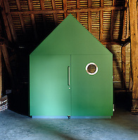 All the electrical, gas and other services are neatly hidden away in a green shed nicknamed 'monopoly house' by the architect