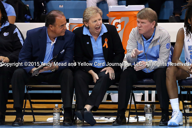 09 November 2015: UNC head coach Sylvia Hatchell (center) with assistant coaches Bill Lee (left) and Andrew Calder (right). The University of North Carolina Tar Heels hosted the University of Mount Olive Trojans at Carmichael Arena in Chapel Hill, North Carolina in a 2015-16 NCAA Women's Basketball exhibition game. UNC won the game 99-45.