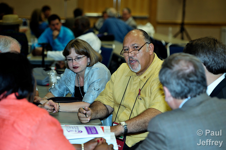 "Delegates to the 2012 United Methodist General Conference in Tampa, Florida, engage in ""holy conferencing,"" a series of structured conversations on controversial issues that the quadrennial legislative gathering is addressing. Participants include Rudolph Merab from Liberia."