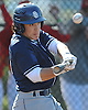 Greg Tan #11, St. Dominic catcher, plates a run with a sacrifice fly in the top of the second inning of a CHSAA varsity baseball game against Chaminade at Cantiague Park on Monday, May 16, 2016. St. Dominic won by a score of 14-3.