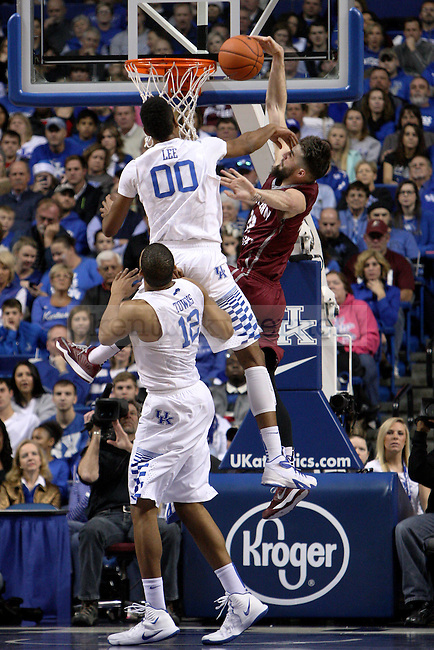 UK forward Marcus Lee (00) fouls EKU guard Timmy Knipp (22) during the second half of the University of Kentucky men's basketball game vs. Eastern Kentucky University at Rupp Arena in Lexington, Ky., on Sunday, December 7, 2014. UK won 82 - 49. Photo by Tessa Lighty | Staff