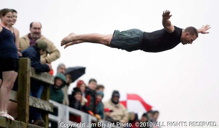 Brian Coppinger,of Port Orchard, Washington, dives off the bridge into the Burley lagoon during the 23rd annual Olalla polar bear jump in Olalla, Washington on January 1, 2007. Jim Bryant Photo. ©2010. ALL RIGHTS RESERVED.