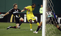 7 May 2005. DC United's Bryan Namoff (26) closes in on Columbus Crew forward Marcus Storey (18) as he shoots towards DC United goalkeeper Nick Rimando (18) at RFK Stadium in Washington, DC.