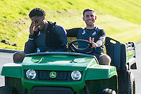 Thursday  13 October 2016<br /> Pictured: ( L-R ) Leroy Fer and Angel Rangel of Swansea City take a drive in the groundkeeper's truck ahead of training <br /> Re: Swansea City FC training session at the Fairwood training ground, Swansea, Wales, UK