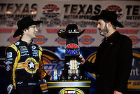 Nov. 8, 2009; Fort Worth, TX, USA; NASCAR Sprint Cup Series driver Kurt Busch (left) speaks with track president Eddie Gossage after winning the Dickies 500 at the Texas Motor Speedway. Mandatory Credit: Mark J. Rebilas-