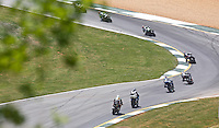 A pack of motorcycles races through the esses at the AMA Superbike Showdown at Road ATlanta, Braselton, GA, April 2010.  (Photo by Brian Cleary/www.bcpix.com)