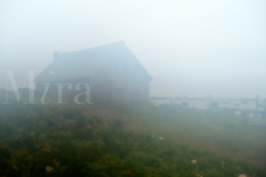 Scenic boathouse shrouded in fog, Chatham, Cape Cod, MA