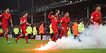 Liverpool players celebrates Sadio Mané of Liverpool scoring as flares are thrown during the English Premier League match at Goodison Park, Liverpool. Picture date: December 19th, 2016. Photo credit should read: Lynne Cameron/Sportimage