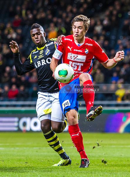 Solna 2013-09-30 Fotboll Allsvenskan AIK - &Ouml;sters IF :  <br /> &Ouml;ster 25 Johan Andersson i kamp om bollen med AIK 12 Christian Kouakou <br /> (Foto: Kenta J&ouml;nsson) Nyckelord: