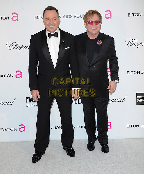 David Furnish, Elton John.The 21st Annual Elton John AIDS Foundation Academy Awards Viewing Party held at The City of West Hollywood Park in West Hollywood, California, USA..February 24th, 2013.oscars full length suit tuxedo white shirt couple life partners pink sunglasses shades brooch flower black .CAP/DVS.©DVS/Capital Pictures.