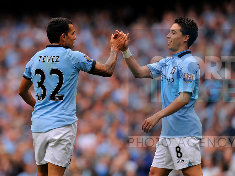 Carlos Tevez of Manchester City and Samir Nasri of Manchester City celebrate.Manchester City v Southampton in the Barclays Premiership match at the Etihad Stadium, Manchester, United Kingdom on the 19th August 2012..Pic Simon Bellis/SPORTIMAGE.