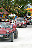 Cruise line visitors rent beach buggies in Costa Maya, Mexico south of Cancun on the Mexican Riveria.