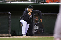 Kannapolis Intimidators manager Justin Jirschele (9) gives signs to his catcher during the game against the Lakewood BlueClaws at Kannapolis Intimidators Stadium on April 6, 2017 in Kannapolis, North Carolina.  The BlueClaws defeated the Intimidators 7-5.  (Brian Westerholt/Four Seam Images)