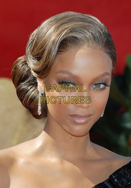 TYRA BANKS.58th Annual Primetime Emmy Awards held at the Shrine Auditorium, Los Angeles, California, USA..August 27th, 2006.Ref: ADM/CH.headshot portrait dangling earrings.www.capitalpictures.com.sales@capitalpictures.com.©Charles Harris/AdMedia/Capital Pictures.
