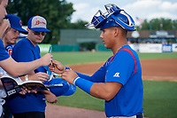 South Bend Cubs catcher Miguel Amaya (9) signs autographs for fans before a game against the Kane County Cougars on July 21, 2018 at Northwestern Medicine Field in Geneva, Illinois.  South Bend defeated Kane County 4-2.  (Mike Janes/Four Seam Images)