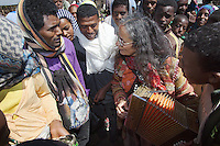 "Ethiopia. Southern Nations, Nationalities, and Peoples' Region. Bojeber Village. High altitude: 3'250 metres. Market day. Chantal Marguerie plays accordion to a group of ethiopian farmers from the Gourague tribe. Marc Vella is a french musician and a nomadic pianist. Over the last 25 years he has travelled with his Grand Piano in around forty countries to celebrate humanity. Creator of ""La Caravane amoureuse"" (The Caravan of Love) he takes people with him to say ""I love you"" to others and ""lovingly conquered"" their hearts and souls. Southern Nations, Nationalities, and Peoples' Region (often abbreviated as SNNPR) is one of the nine ethnic divisions of Ethiopia. 15.11.15 © 2015 Didier Ruef"