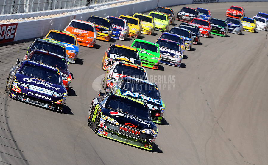 Feb. 28, 2010; Las Vegas, NV, USA; NASCAR Sprint Cup Series driver Jeff Gordon (24) leads Matt Kenseth (17) during the Shelby American at Las Vegas Motor Speedway. Mandatory Credit: Mark J. Rebilas-