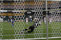 Guatemala forward Carlos Ruiz (20) scores against Paraguay goalkeeper Justo VIllar (1) from a penalty kick.  Guatemala tied Paraguay 3-3 in a international friendly match at RFK Stadium, Wednesday August 15, 2012.