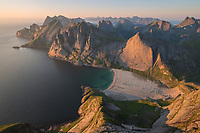 Summer twilight over Bunes beach from Storskiva mountain peak, Moskenesøy, Lofoten Islands, Norway