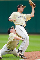 Wake Forest Demon Deacons right fielder Jack Carey #20 collides with second baseman Mark Rhine #2 as Rhine catches a foul pop fly against the North Carolina State Wolfpack at Doak Field at Dail Park on March 17, 2012 in Raleigh, North Carolina.  The Wolfpack defeated the Demon Deacons 6-2.  (Brian Westerholt/Four Seam Images)